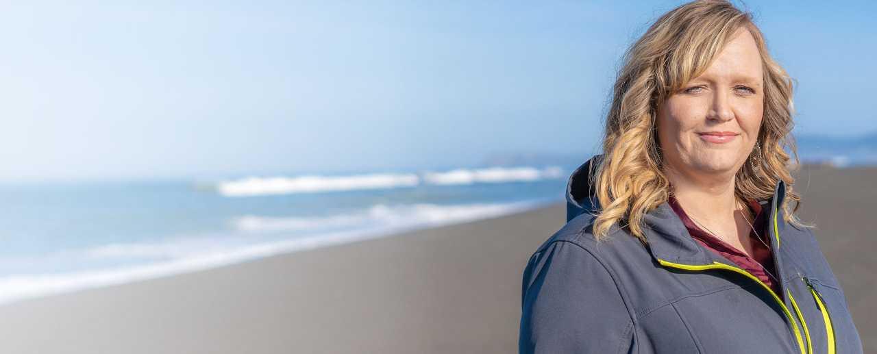 Woman outdoors smiling at camera